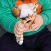 """Детская игрушка """"Силиконовый держатель-гризунець Динозавр"""""""
